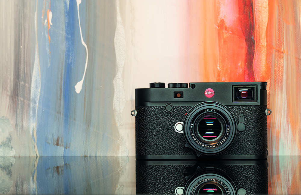 Leica M10-R in front of a Canvas Painting