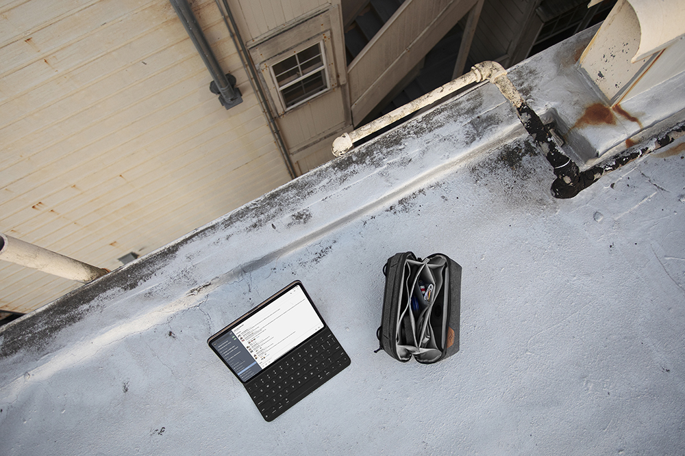 Tech Pouch with Laptop on building